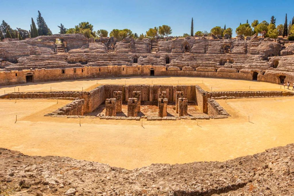 Photo of the amphitheater in Italica, Spain, one of the coolest day trips from Spain