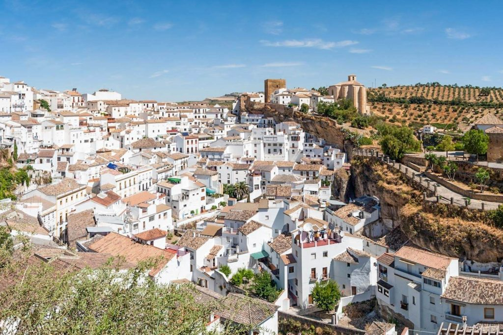 A bird's eye view of Setenil de las Bodegas and all of its white homes on a hill