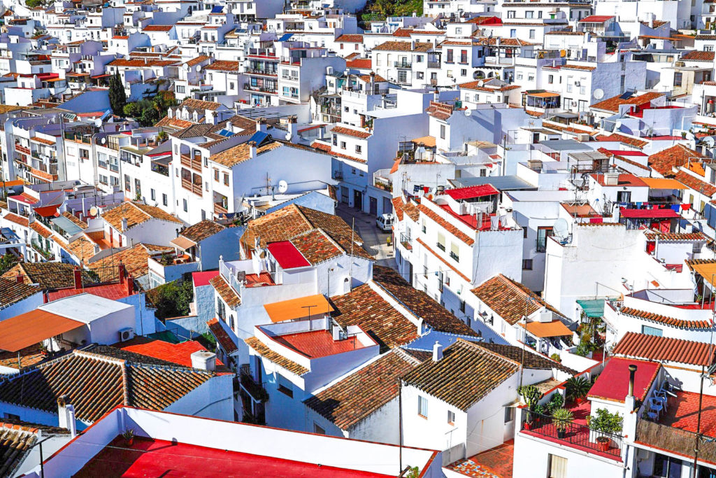A view of Mijas, with dozens of white homes on a hill.