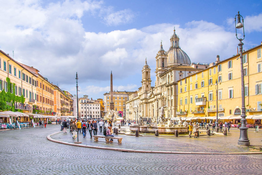 A view of Piazza Navona, with its curved shape and many historical buildings in sight