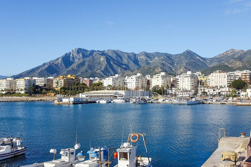 View of port in Marbella with mountains in the background