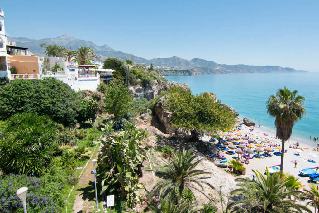 View from the Balcon de Europa in Nerja, Spain with a view of the beach and mountains